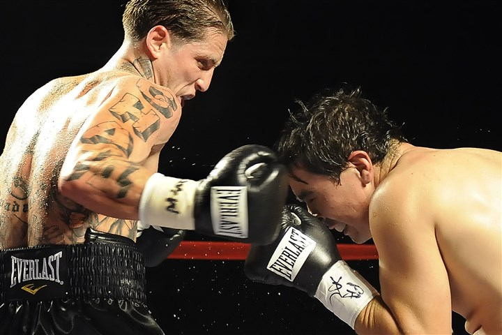 spaddy1129 Paul Spadafora, left, lands a right to the head of Ivan Bustos in a 2009 fight at Station Square.