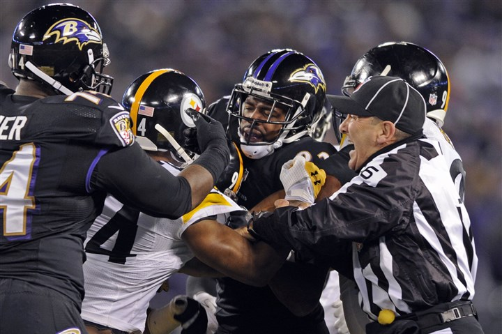 1128mhSteelersVsRavensSports06-2 Referees attempt to break up a post-whistle scuffle between the Steelers and the Ravens in Baltimore on Thanksgiving.