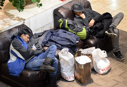20131129dsBlackFridayLocal01.jpg Darsh Shah and Aashir Gajjar, both of Shadyside, take an early-morning snooze Friday at the Mall at Robinson. They were with a party of seven shoppers and arrived at midnight for the opening of the mall.