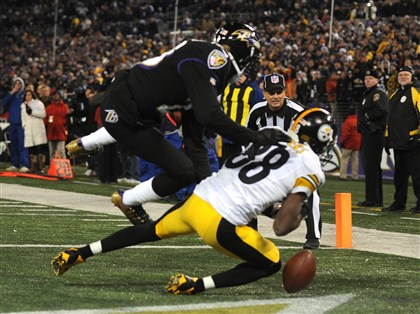 1128mhSteelersVsRavensSports15 Emmanuel Sanders fumbles a pass in the last minute of the game against Baltimore. The Ravens won, 22-20.