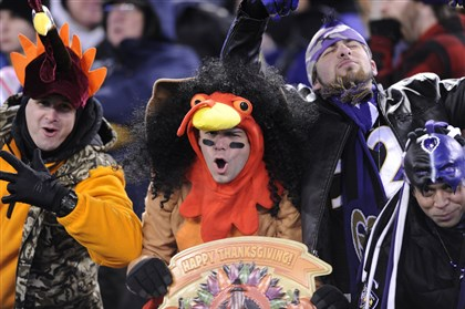 1128mhSteelersVsRavensSports22-3 Fans support their teams while still enjoying the Thanksgiving holiday in Baltimore.