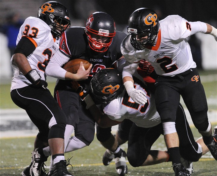 20131129JHSportsFB04 West Allegheny quarterback Andrew Koester is stopped by Erie Cathedral Prep defenders in the first half Friday at North Allegheny. West Allegheny lost, 28-0.