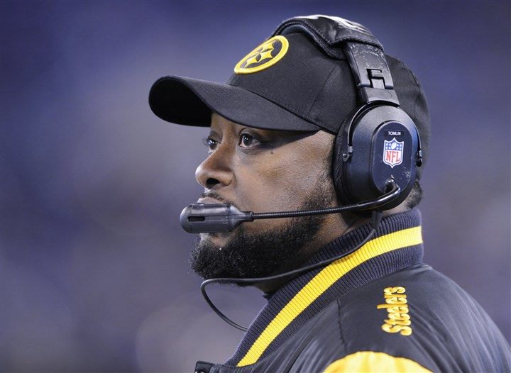 1128mhSteelersVsRavensSports20-1 Head coach Mike Tomlin watches the Steelers play against the Baltimore Ravens during the third quarter in Baltimore on Thursday.