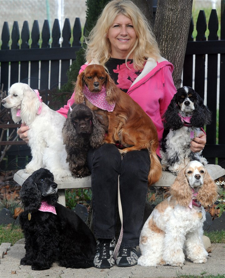 Bernadette Kazar and dogs Bernadette Kazar with her pups. On the bench: Revlon, Chanel, Avon (with pink kerchief) and Laurel. On the ground: Godiva and Olay.
