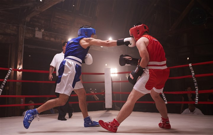 "Pittsburgh ""White Collar Brawlers"" Pittsburgh's Allen Lu, left, and Paul Matthews square off in Esquire Network's ""White Collar Brawler."""
