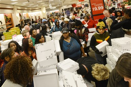 Holiday Shopping Customers fill the shoe department at the Belk department store in Kinston, N.C.