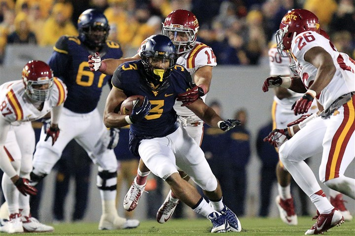 Iowa St West Virginia Football WVU running back Charles Sims carries the ball in last season's triple overtime loss to Iowa State. The Mountaineer open the 2014 season against Alabama.