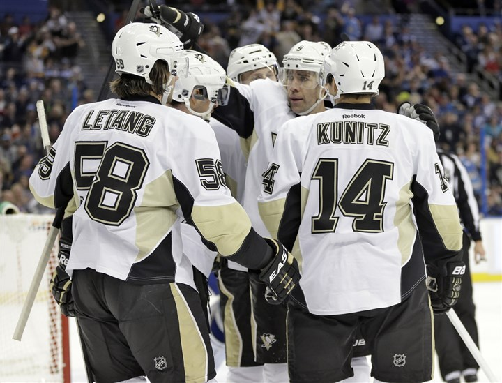 pens1130a Pascal Dupuis and teammates celebrate a goal by Chris Kunitz in the first period Friday against the Lightning in Tampa, Fla.