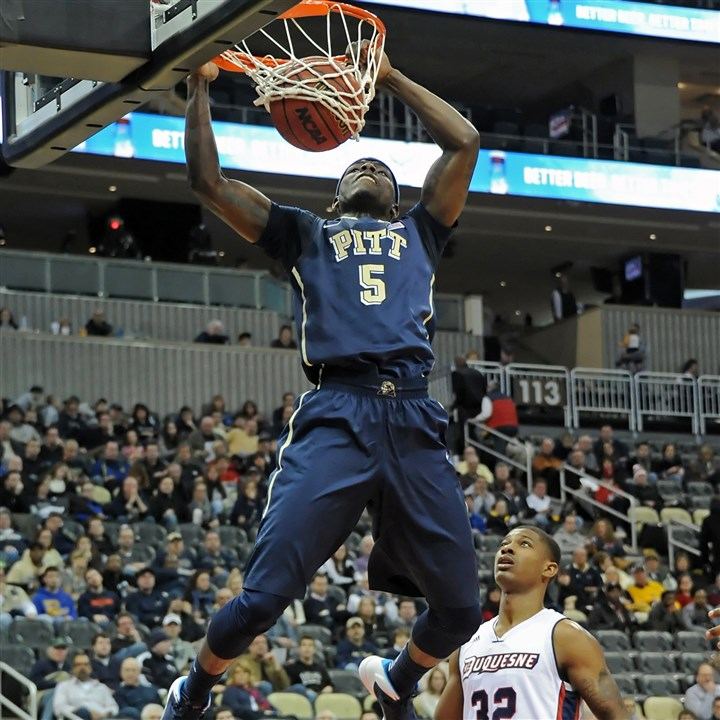 duquesne pittsburgh basketball Pitt's Durand Johnson dunks in front of Duquesne's Desmond Ridenour during a game last season.