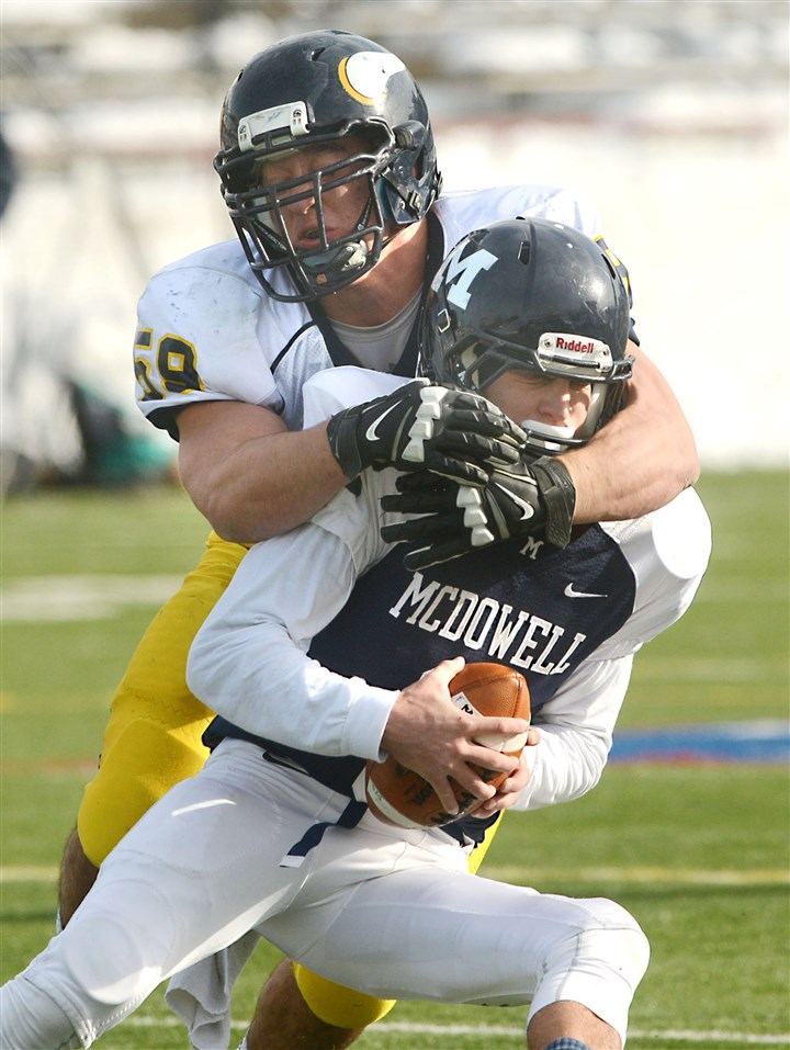 hsquadcentral1201b Central Catholic's Zack DeLuca sacks McDowell quarterback Jake Tarasovitch in the first quarter of the PIAA Class AAAA football quarterfinal game at Veterans Stadium in Erie, on Nov. 30.