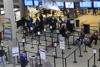 Passengers move through the security line at Pittsburgh International Airport in December.