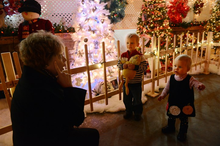 20131130bwTreesWest02-1 Gayle Piroli of Center Township keeps an eye on her grandchildren, Tyler Piroli, 3, and his sister Paige, 1, from Moon Township as they tour the Beaver County Festival of Trees.