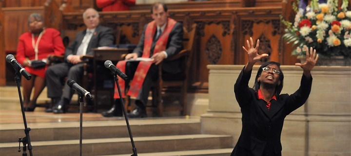 "20131201lraidslocal08-5 Tina King uses sign language while dancing to ""Balm in Gilead"" during the World AIDS Day interfaith service Sunday at East Liberty Presbyterian Church."