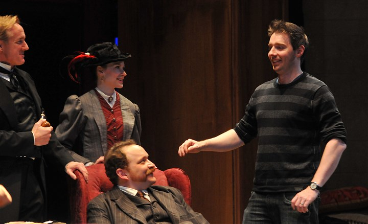 "20131201lrpictmag17-13 ""The Crucifer of Blood,"" is directed by Matt Torney, right. Sherlock Holmes, played by David Whalen, left, speaks to Justin R.G. Holcomb (Dr. Watson), seated, and Gayle Pazerski (Lily St. Claire)."