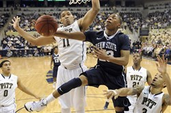 Penn State's Tim Frazier drives to the net against Pitt in December 2013, the last time the Panthers and Nittany Lions played.