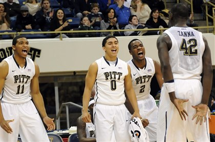 20131203mfpittsports07-4 Pitt players Derrick Randall, James Robinson and Michael Young celebrate a basket by Talib Zanna against Penn State in the second half at the Petersen Events Center Tuesday night.
