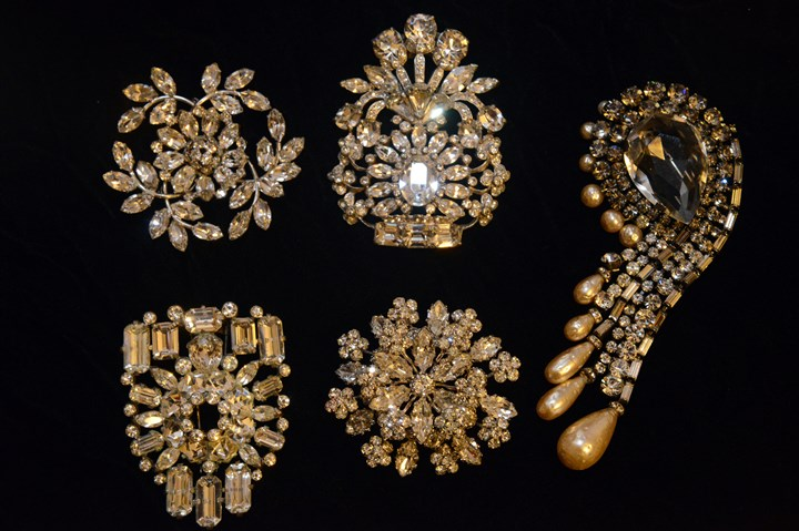 Pat Walt collection Part of Pat Walt's rhinestone collection including, top left, a Fred Block pin; top center and bottom left, Eisenberg Original fur clips; bottom center, a Schreiner pin; and at right, a German pin.