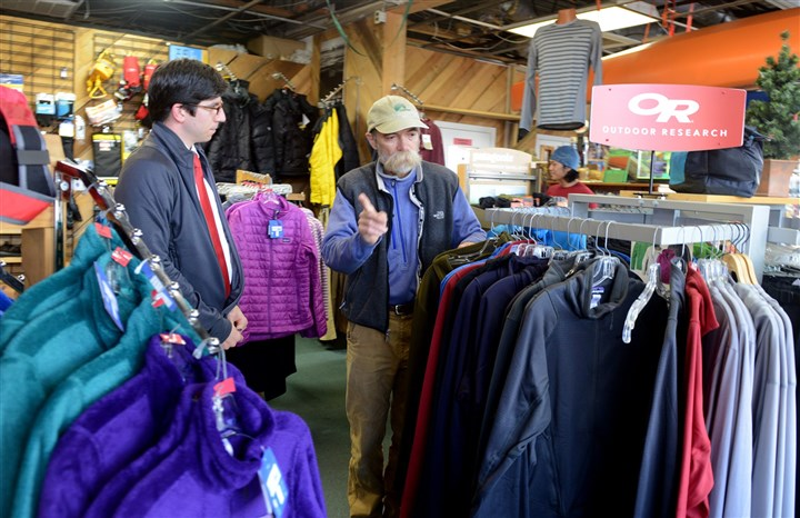 20131203RARlocalexkursions2-2 Fred Gunter, owner of the Exkursion outdoor store in Monroeville, helps Bernard John of Sewickley look for a jacket.
