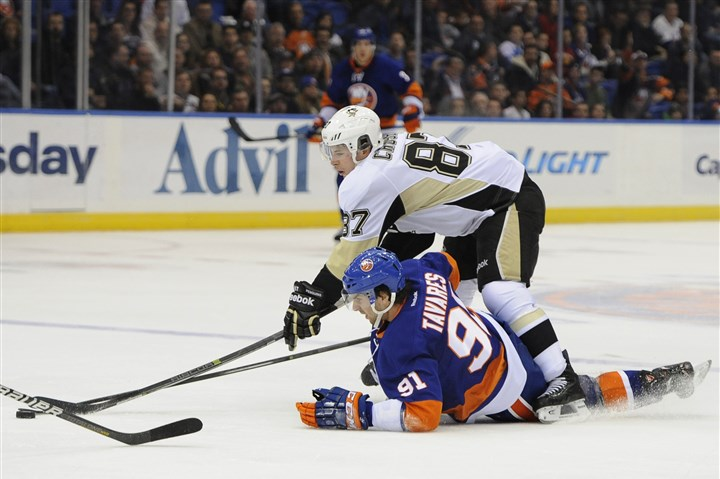 pennot0124 New York's John Tavares and Penguins star Sidney Crosby battle for the puck in a game earlier this season.