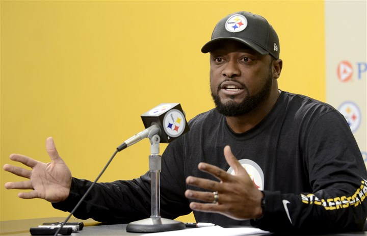 20131203arTomlin03-2 Steelers coach Mike Tomlin speaks to the media about his 'sideline blunder' during last week's Ravens game during his weekly press conference about his at the Steelers South Side training facility on Tuesday.