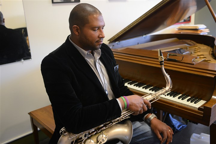 "20131208NewtownLoveLOCAL07-4 Jimmy Greene, who teaches music at Western Connecticut State University, couldn't play for a month after his daughter Ana was killed at Sandy Hook. He later composed ""Ana's Way,"" a soulful song he jokingly admits his daughter may not like."