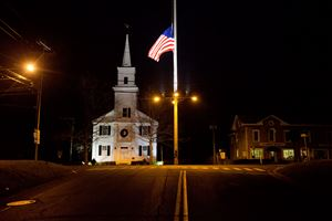A U.S. flag flies at half-staff on Main Street Saturday, Dec. 15, 2012, in Newtown, Conn. in honor of the people killed when a gunman opened fire inside a Connecticut elementary school Dec. 14.