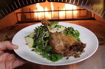 20131204lrdiningmag01 A confit of duck leg on an arugula salad at Toast, prepared by Chef Chet Garland.