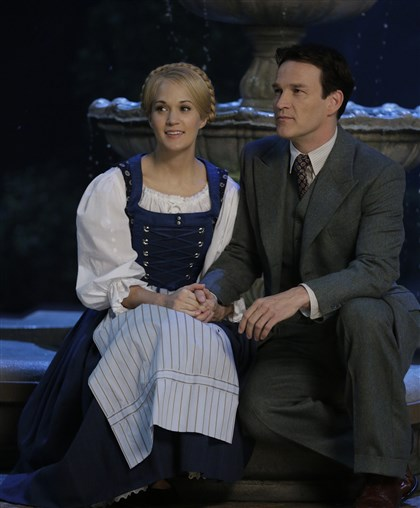 "SoundofMusic Carrie Underwood will portray Maria and Stephen Moyer will be Captain Von Trapp in ""The Sound of Music Live!"" It airs at 8 tonight on NBC under the direction of Park Point alumnus and Tony winner Rob Ashford."