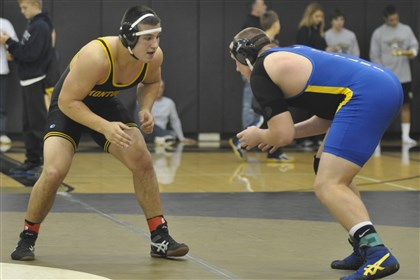 9ax00kjb.jpg Montour's Cole Macek, left, competed against West Mifflin's James Keys during the 220-pound championship match at the Eastern Area Invitational Tournament at Gateway High Schoo last year.