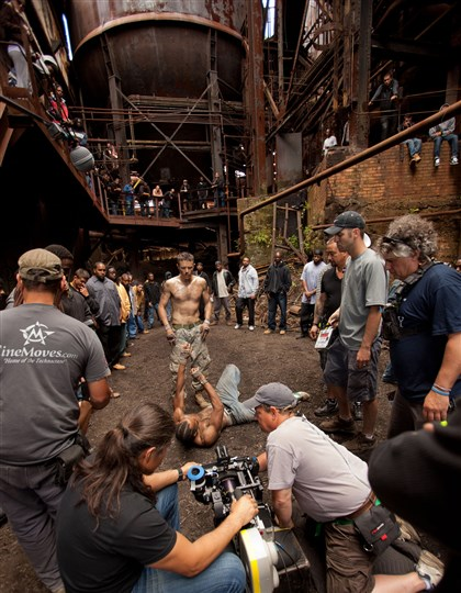 "OUT OF THE FURNACE Star Casey Affleck (center) on the set of ""Out of the Furnace."""