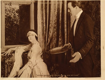 "DeMille A scene from Cecil B. DeMille's silent film ""Male and Female."""