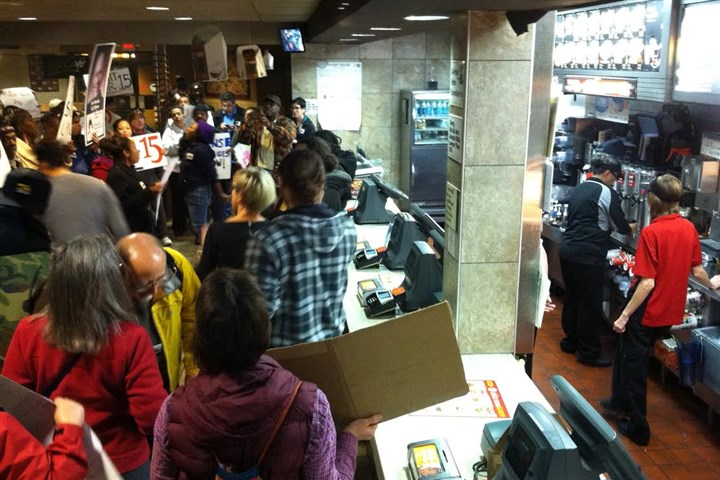 120513_protest.jpg Participants in a rally fill the McDonald's at the corner of Stanwix Street and Liberty Avenue this morning.