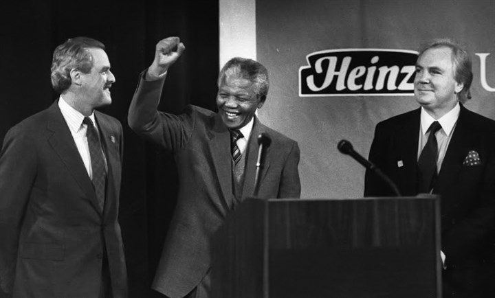 012mandela-11 Nelson Mandela greets an audience gathered to hear him speak in Oakland in 1991. He is flanked by University of Pittsburgh President J. Dennis O'Connor and Anthony J.F. O'Reilly, chairman of H.J. Heinz Co.