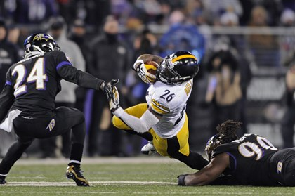 steele1207 Steelers rookie running back Le'Veon Bell attempts to avoid a tackle against the Ravens on Thanksgiving night.