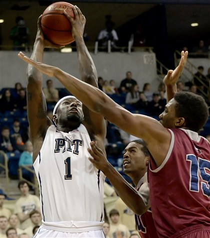 20131206mfpittsports08-23 Jamel Artis drives against Loyola Marymount's Alex Osborne in the first half Friday at Petersen Events Center.