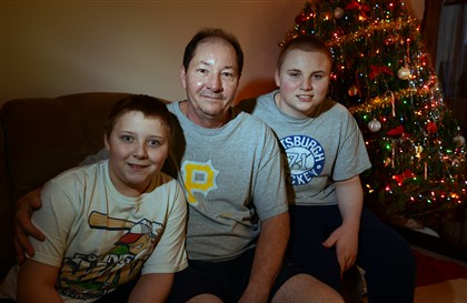 20131206bwGoodLocal01 Don Zagrocki, center, with his sons, Kyle, 12, left, and Donny, 14, in their Baldwin Borough apartment.