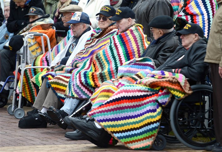 20131206MWHmemorialLocal09.jpg A group of WWII veterans from the Southwestern Veterans Center sit draped in blankets during the dedication of the Southwestern Pennsylvania World War II Memorial and dedication on the North Shore Friday.