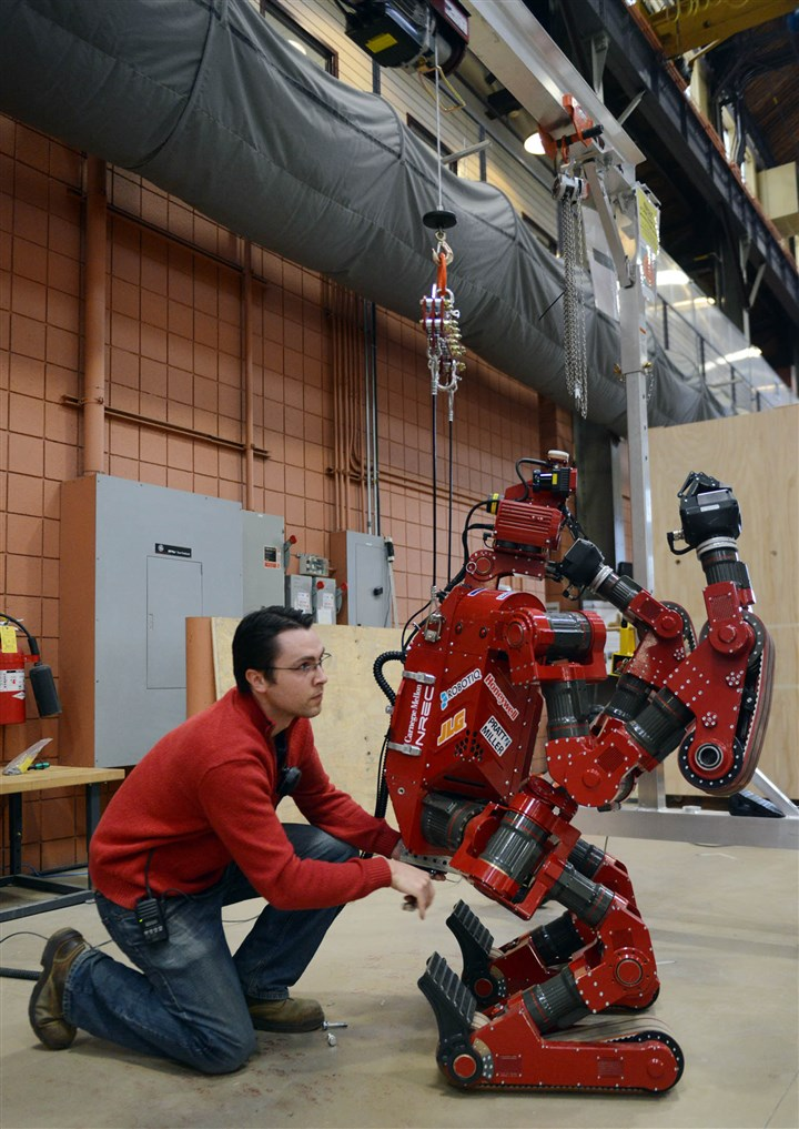 20131204MWHchimpLocal01 Brian Zajac, a robotic engineer, works with the CHIMP robot Wednesday at Carnegie Mellon University's National Robotics Engineering Center in Lawrenceville.