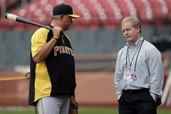 nealhuntington-1 Pirates manager Clint Hurdle, left, talks with general manager Neal Huntington, right, during a workout at Busch Stadium, Wednesday, Oct. 2, 2013, in St. Louis on the eve of Game 1 of the National League Division Series baseball playoff between the Pirates and the St. Louis Cardinals.
