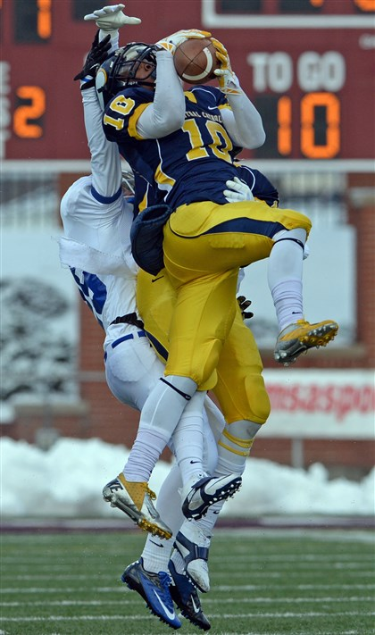 hscentral1208c Central Catholic's Cameron Sutherland intercepts a ball intended for Lower Dauphin's Jake Shellenberger in the PIAA Class AAAA semifinals in Altoona Saturday afternoon.