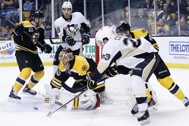 Penguins Bruins Hockey Boston Bruins goalie Tuukka Rask (40) blocks a shot by the Penguins' Chris Conner (23) in the first period.