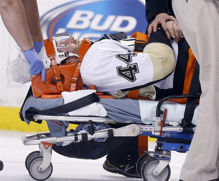 pens4 The Penguins' Brooks Orpik is taken off the ice after being injured in the first period.
