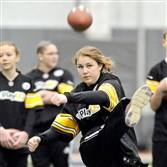 Molly Saylor, now 15, kicks during the 2013  Punt, Pass and Kick competition at the Steelers' indoor practice facility on the South Side.