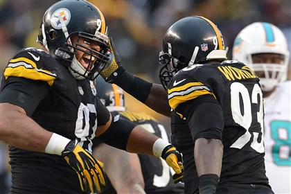 20131208pdSteelersSports15-7 Cameron Heyward celebrates with Jason Worilds after getting a sack against the Dolphins in the fourth quarter Sunday at Heinz Field.