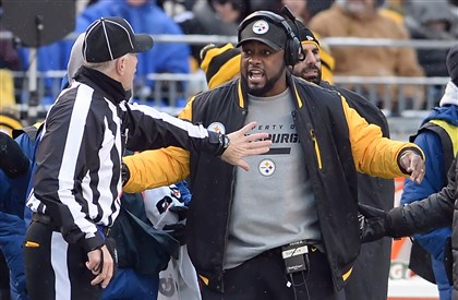 20131208mfsteelerssports10-1 Steelers head coach Mike Tomlin argues for pass interference as they take on the Dolphins in the third quarter of a game alst season at Heinz Field.