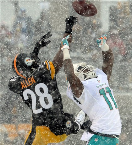 Cortez Allen and Mike Wallace The Steelers' Cortez Allen breaks up a pass intended for the Dolphins' Mike Wallace.