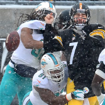 gene1209 Dolphins defensive end Cameron Wake forces a fumble by Steelers quarterback Ben Roethlisberger.