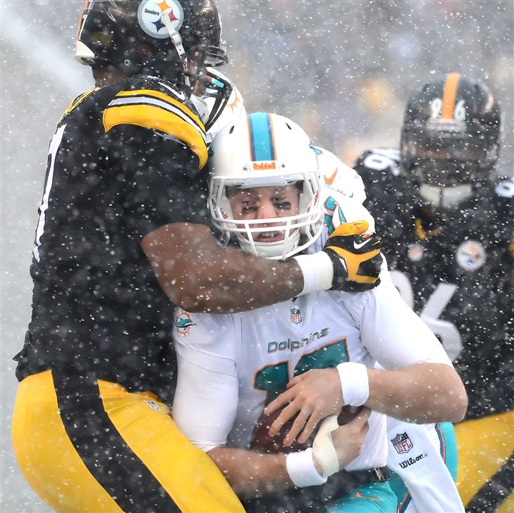 Steelers' Cameron Heyward and Dolphins' Ryan Tannehill The Steelers' Cameron Heyward sacks Dolphins quarterback Ryan Tannehill in the first quarter.