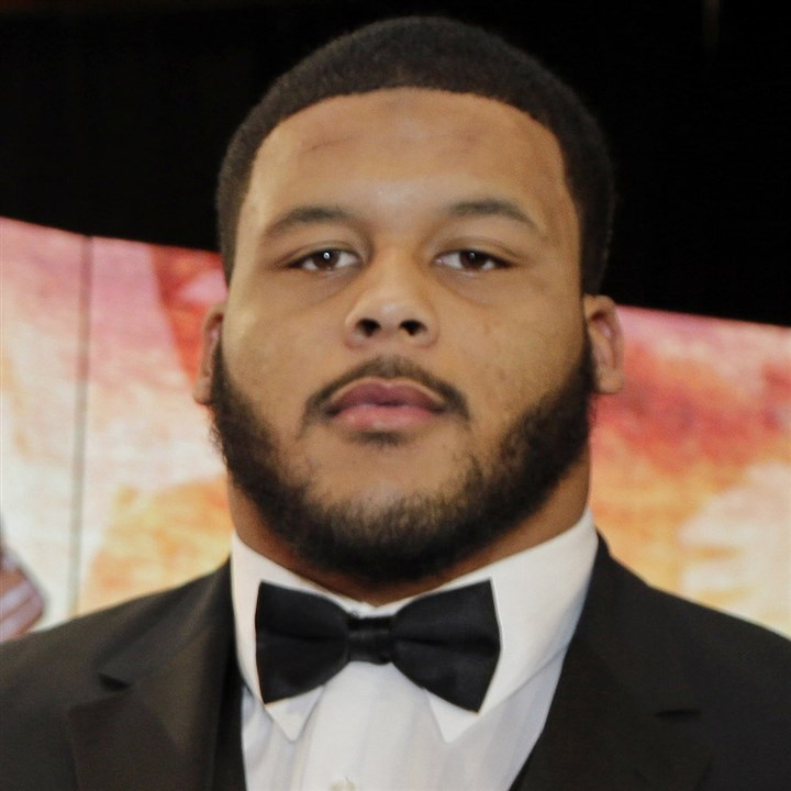 donald1210 Pitt's Aaron Donald poses for a photo with the Bronko Nagurski award for the NCAA college football defensive player of the year Monday night in Charlotte, N.C.