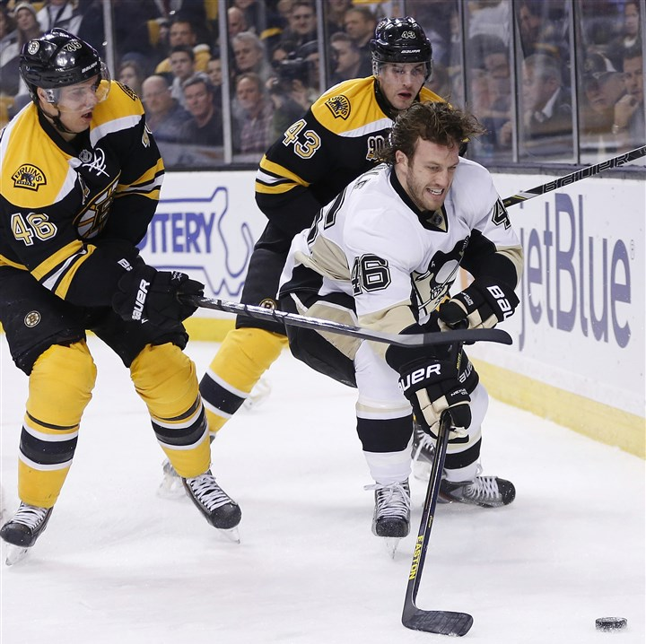 2013 Penguins Bruins Hockey Joe Vitale, center, battles the Boston Bruins' David Krejci, left, and Matt Bartkowski for the puck in the first period in Boston on Dec. 7.